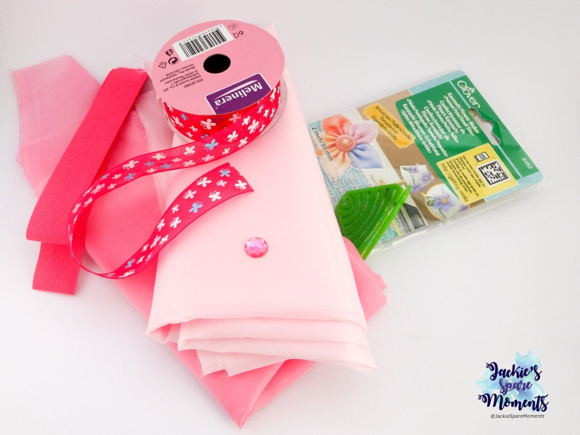 Materials used. Clover Kanzashi maker Pointed Petal small size, fabric, ribbon, elastic, raisin bead