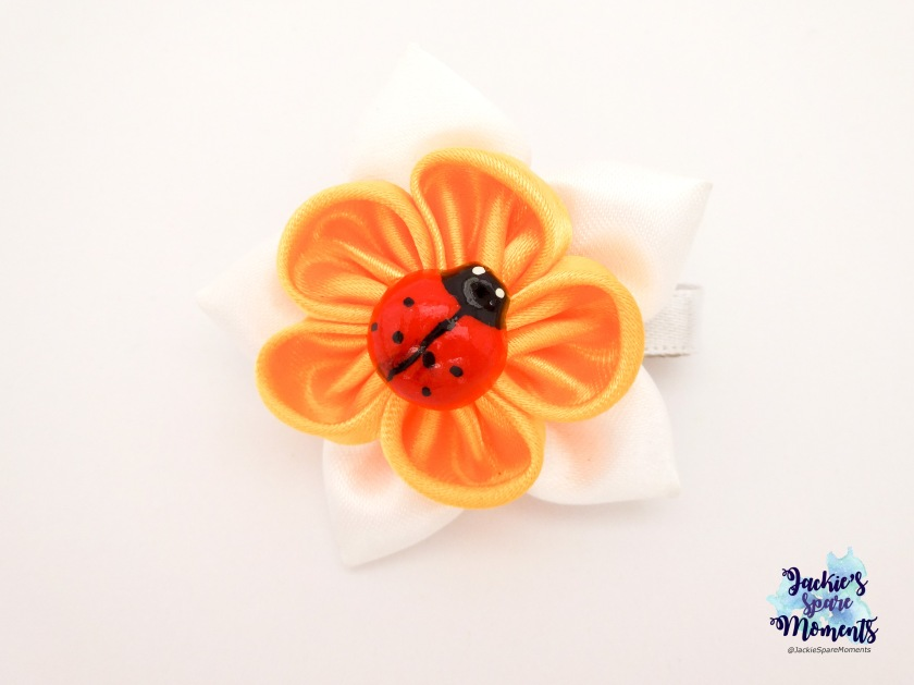 Hair clip daffodil with lady bug