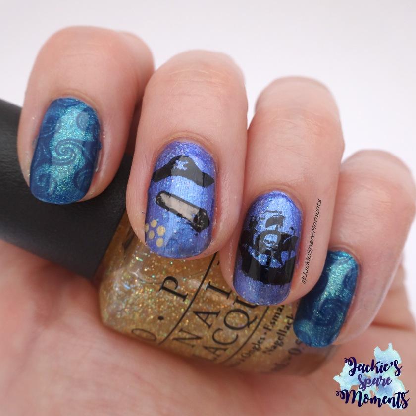 Macro shot of pirate manicure holding OPI I don't speak meek