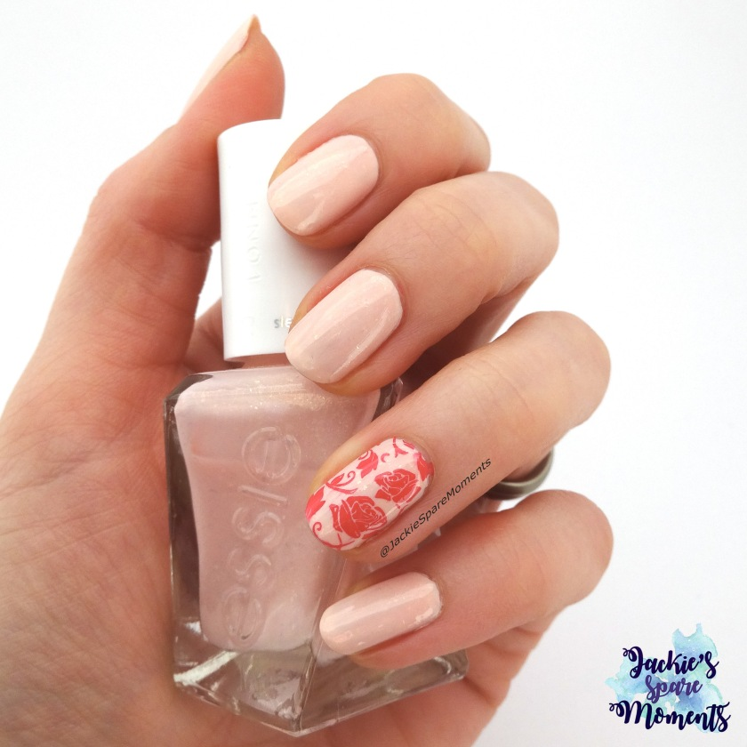 Soft pink nail art with roses using Essie gel couture blush-worthy and Moyra stamping plate 104
