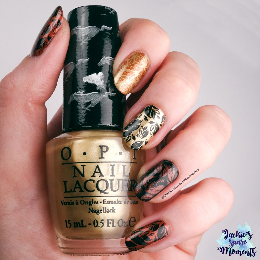 Autumn leaves in Gold, Copper and Black. Holding OPI 50 years of style