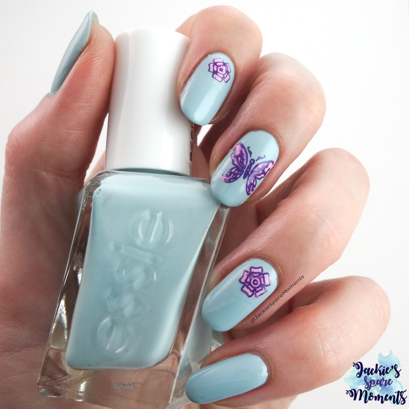 Spring nail art with butterfly using Essie Getting Intricate