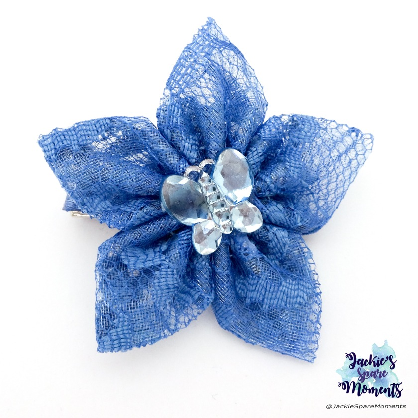 Blue floral hair bow with butterfly