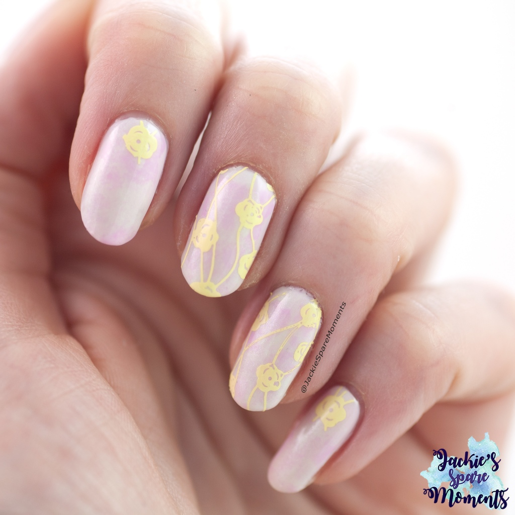 Pastel nail art with floral stamping
