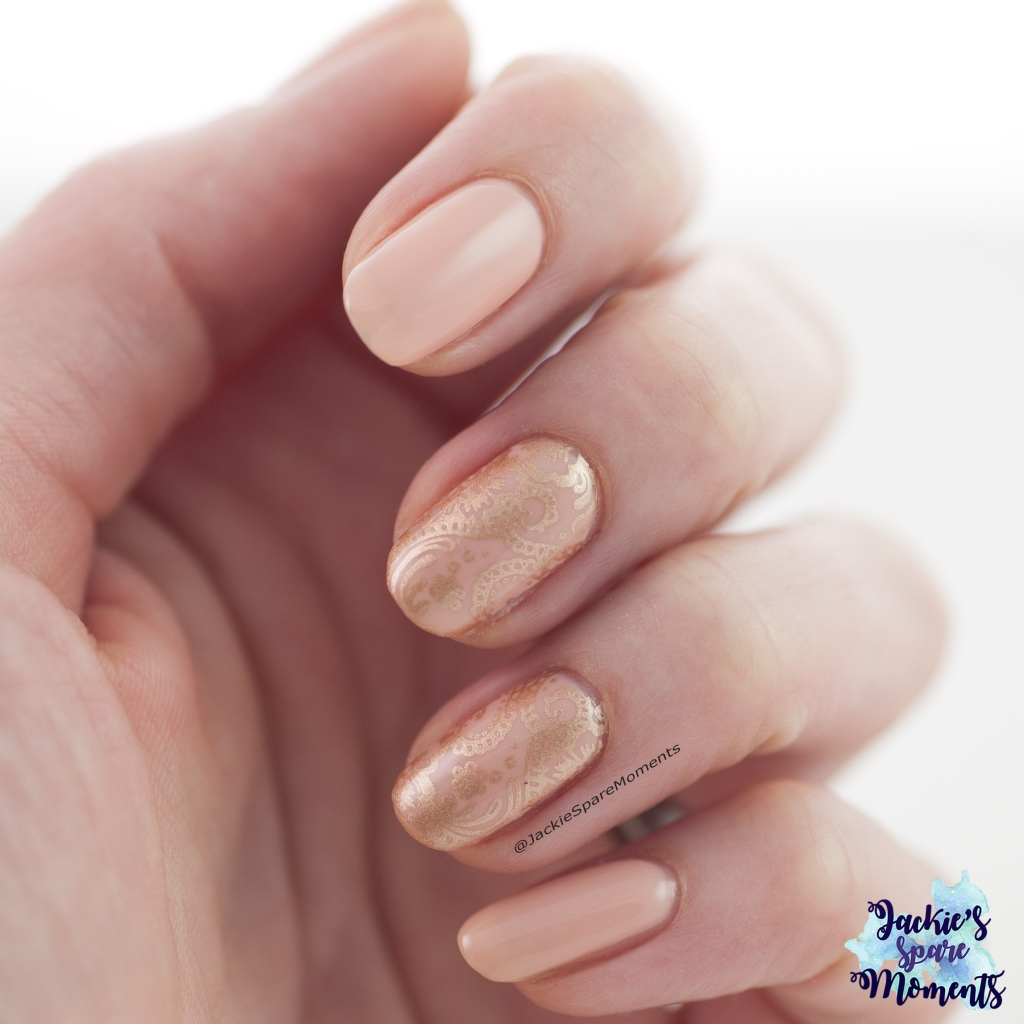 Nude coloured nails with gold stamping