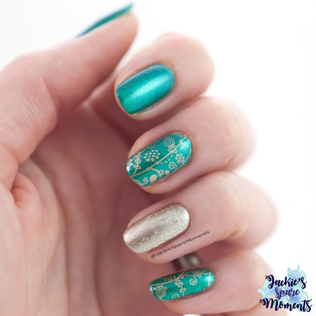 Floral nail art in emerald and gold
