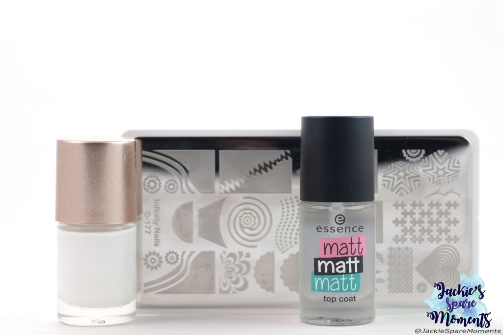 Materials used for negative space nail art: white stamping polish, matte top coat, Dashica stamping plate Infinity Nails 177