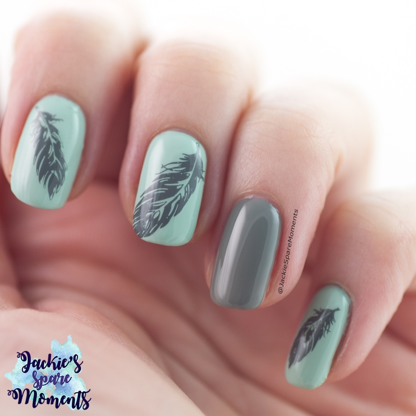 Nail art in grey and mint with stamped feather images