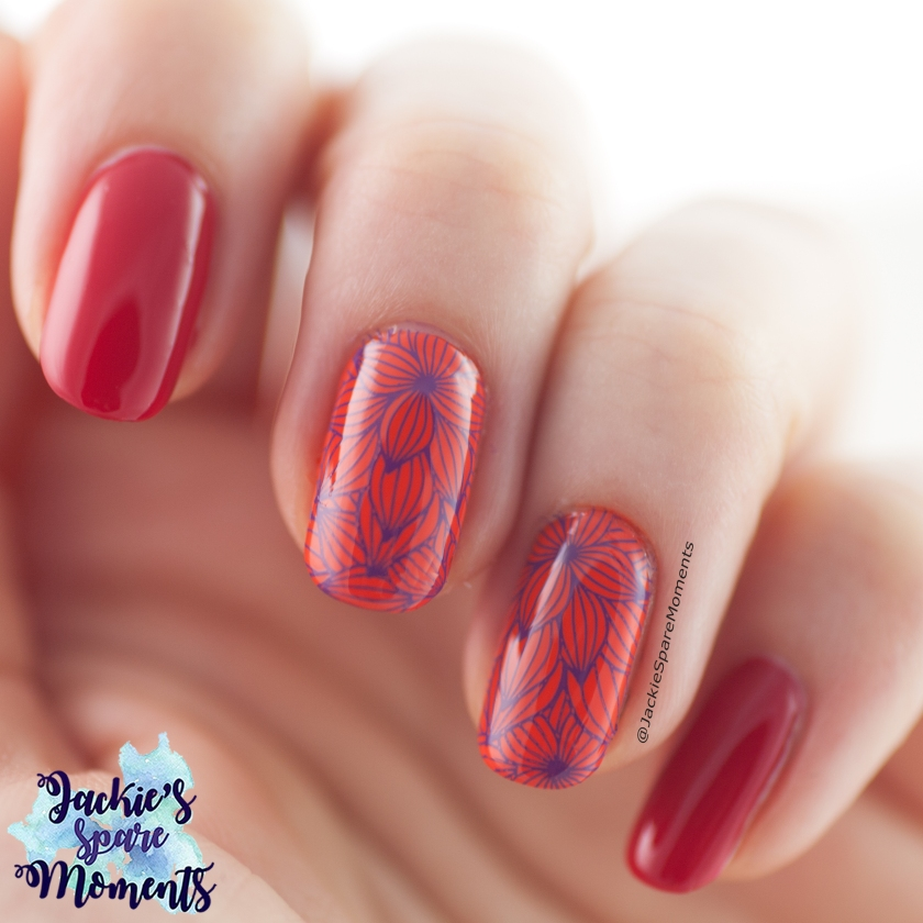 Manicure with red, orange and floral purple stamping