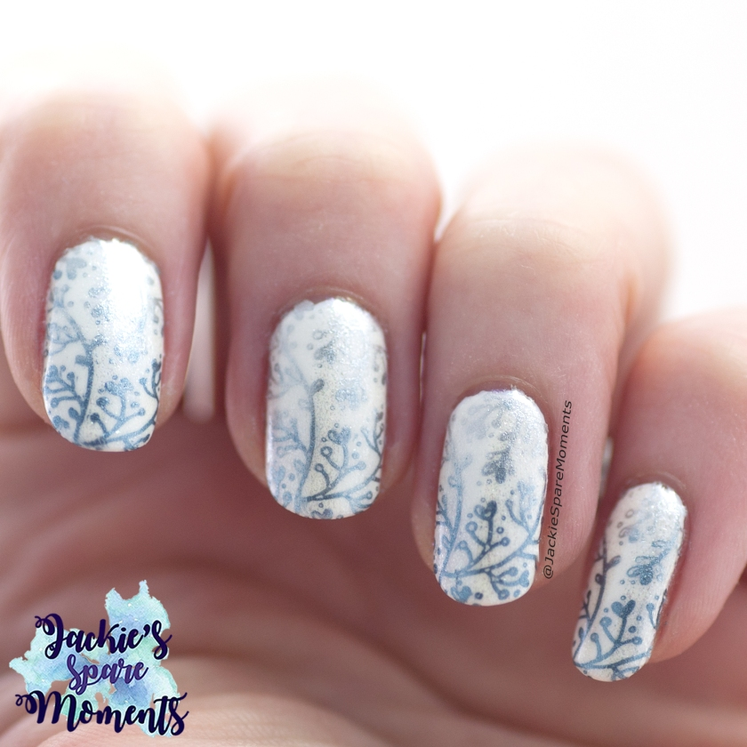 Winter nail art design in White, Blue and Silver