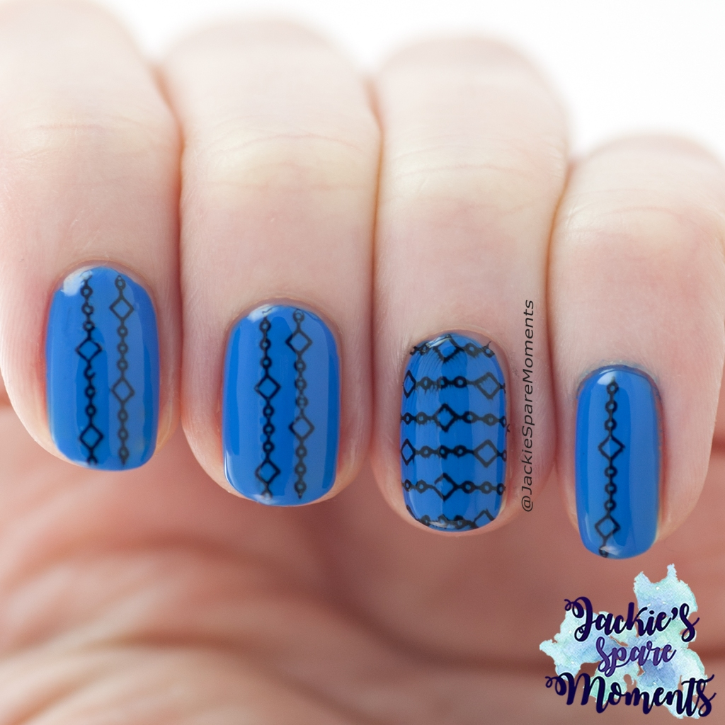 Geometric nail art in blue with black stamping