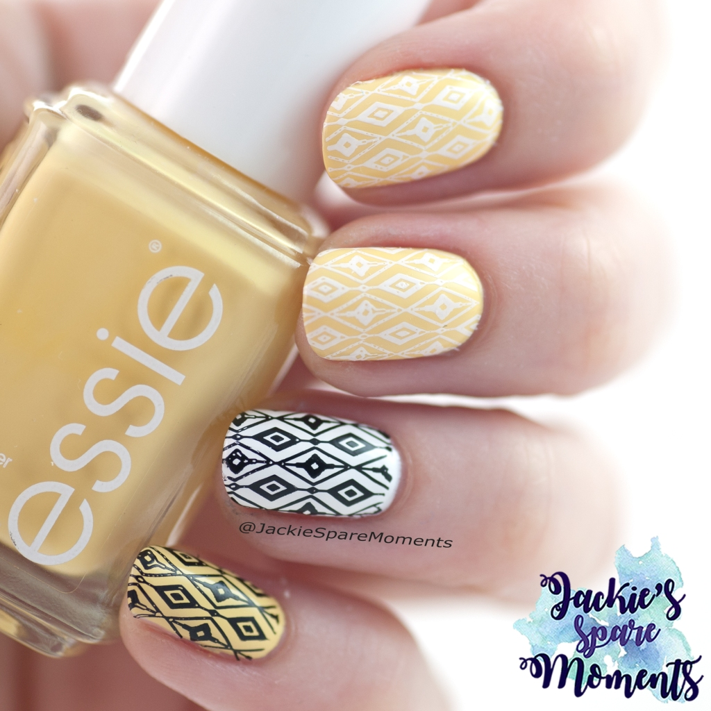 Nail art in yellow, black and white