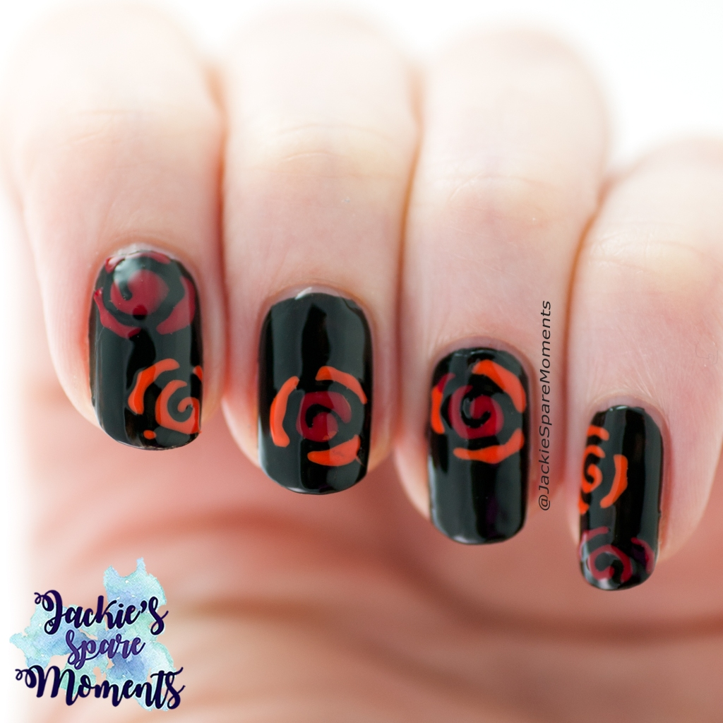 Nail art with orange and red roses on a black background