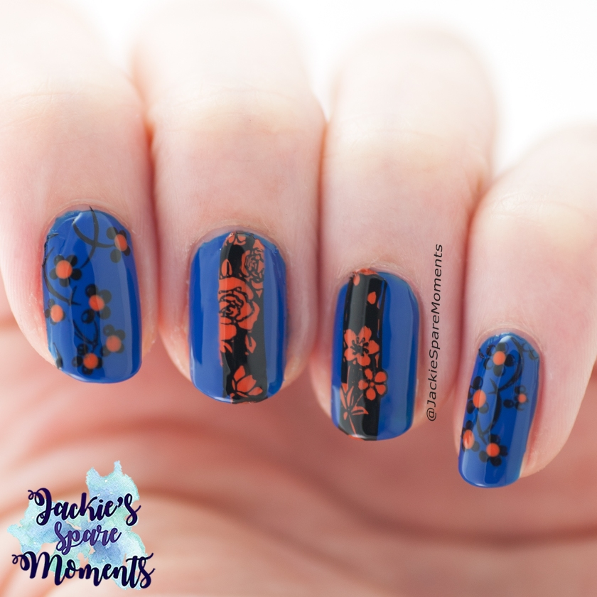 Floral nail art in blue, black and orange