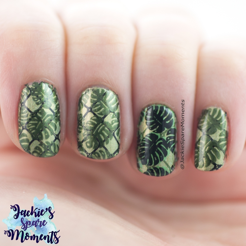 Nail art with stamped tropical leaves in green and black
