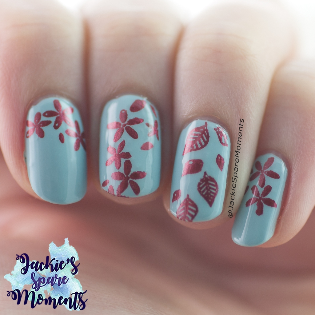 Light blue nails with red stamping images