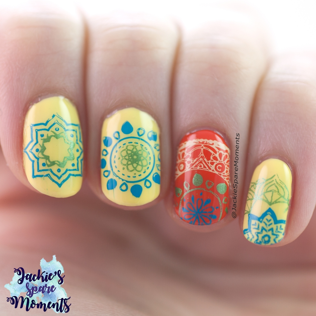 Mandala nail art in blue, green, yellow and orange