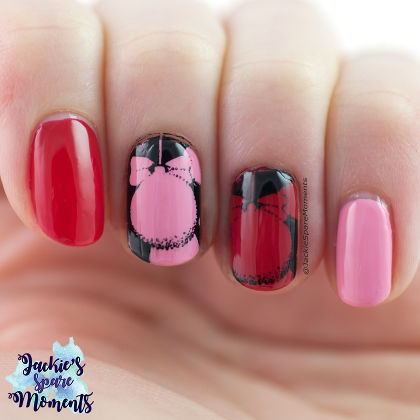 Prink red and black nail art with Christmas ornaments