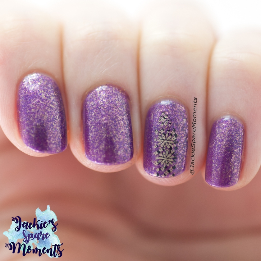 purple nails with candle