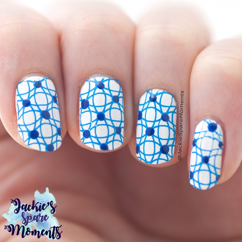 Abstract nail art in white and blue