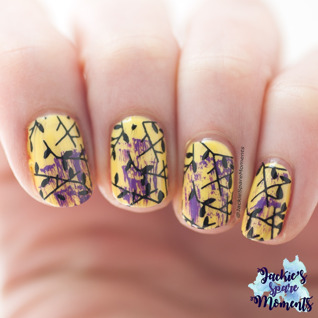 Yellow nails with purple dry brush and black stamping