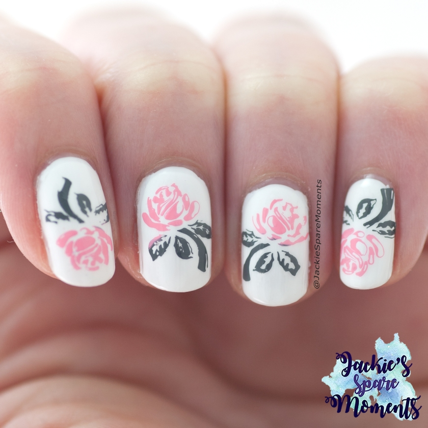 Stamped roses nail art in white, grey and pink.