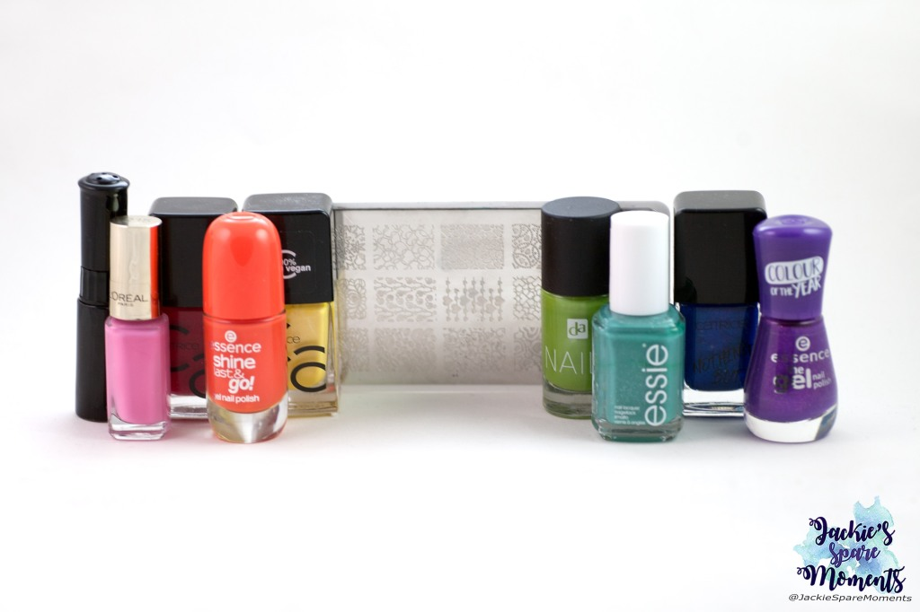 A rainbow of polishes used for pride nail art